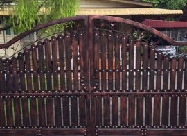 How to remove paint from a rusty metal gate
